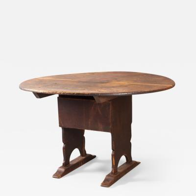 A very fine late 18th century chair table with two board oval top