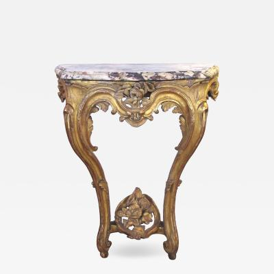 A well carved Italian rococo gilt wood wall console table with marble top