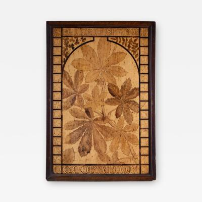 A wooden panel with decorative stained leaves