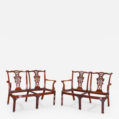 AN IMPRESSIVE AND HIGHLY ATTRACTIVE PAIR OF WALNUT DOUBLE CHAIR BACK SETTEES