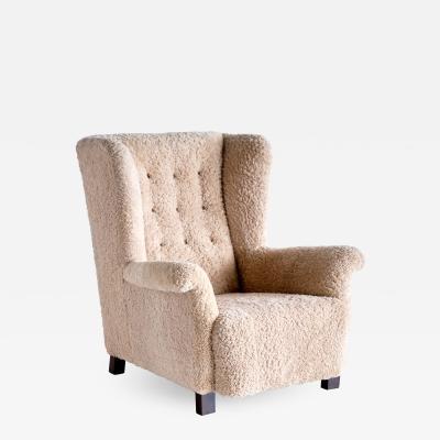 Acton Bj rn Important Acton Bj rn Wingback Chair in Sheepskin A J Iversen Denmark 1937