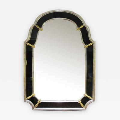An American Hollywood regency silver gilt wood mirror with black glass border