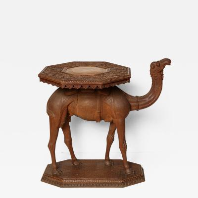 An Anglo Indian Hardwood Camel Side Table