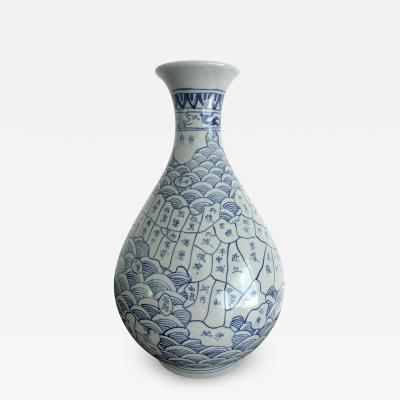 An Antique Japanese Arita Blue and White Map Vase