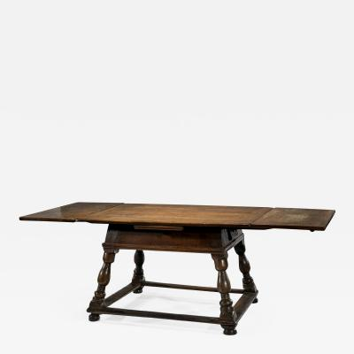 An Antique Swiss Draw leaf Extension Table