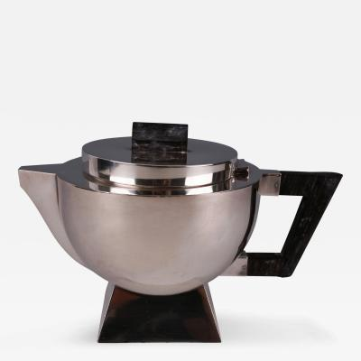 An Art Deco Silver Nickel and Ebony Teapot French ca 1920