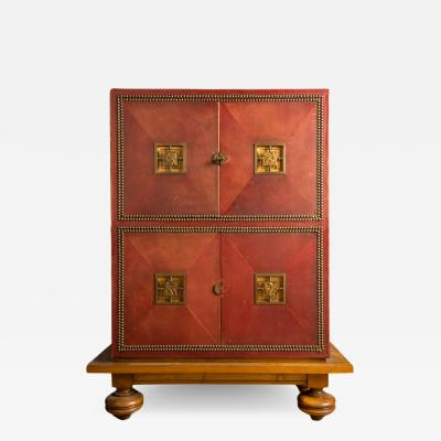 An Art Deco cabinet in deep red leather by M Claude Renard circa 1930