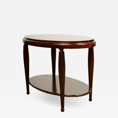 An Art Deco style contemporary table mahogany with fluted legs American