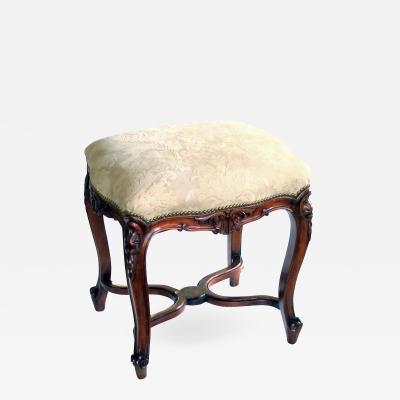 An Elegant French Regence Style Carved Walnut Stool with Cut Suede Upholstery