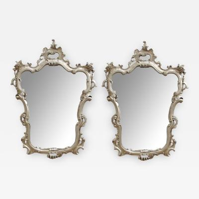 An Elegant Pair of Italian Rococo Style Silver Leafed Gilt Wood Mirrors