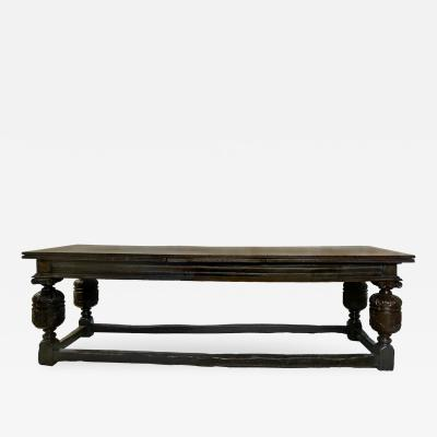 An Elizabethan Style Oak Draw leaf Refectory Table