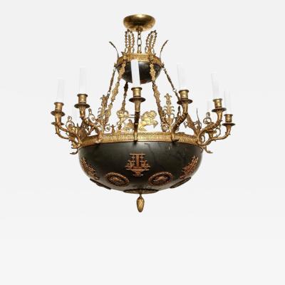 An Empire Ormolu and Tole Twelve Light Chandelier