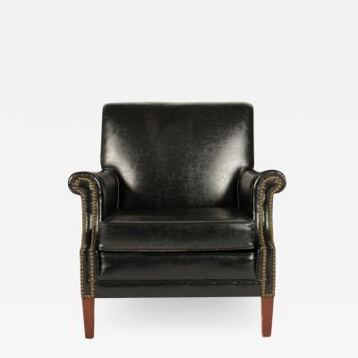 An English leather club chair with nail head details circa 1900