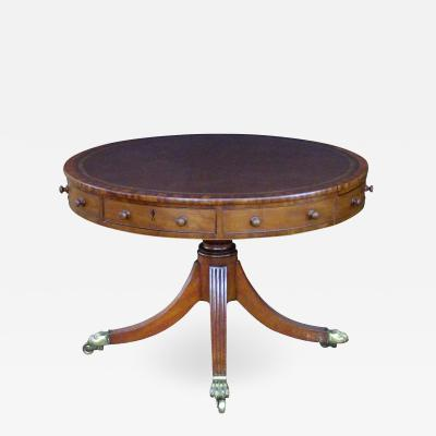 An English regency mahogany center table with embossed leather top