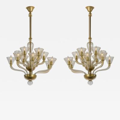 An Exceptional Pair of Murano Gold Aventurine 12 Light Chandeliers