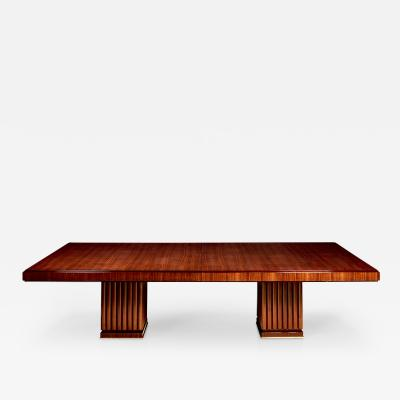 An Extendable Dining Table with Fluted Base by Iliad Design