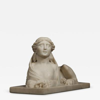 An Imposing Carved Statuary Marble Sculpture Of A Reclining Veiled Female Sphinx