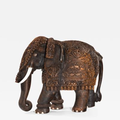 An Indian carved hardwood elephant