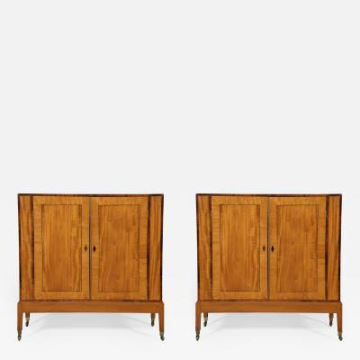 An Interesting Pair of Satinwood Two Door Cabinets En Quatre Face