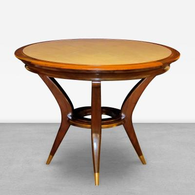 An Italian 1950s circular mahogany game table with reversible parchment top