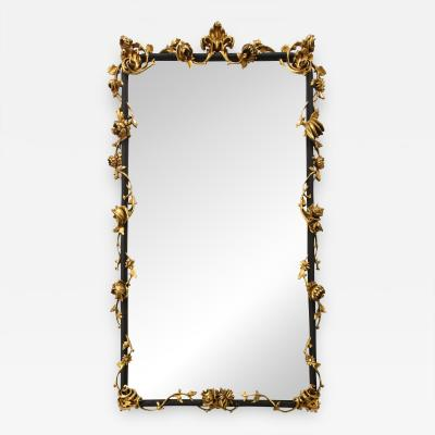 An Italian Rococo style giltwood and black painted wall mirror