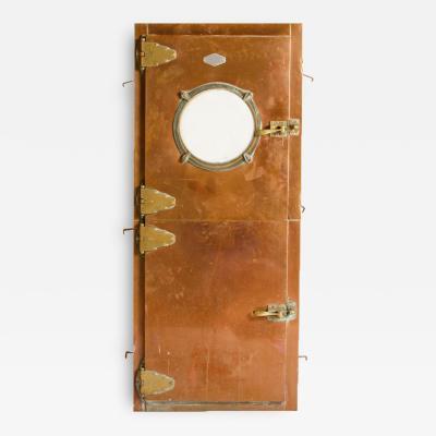 An Italian copper Dutch door circa 1930 with brass hinges Two doors