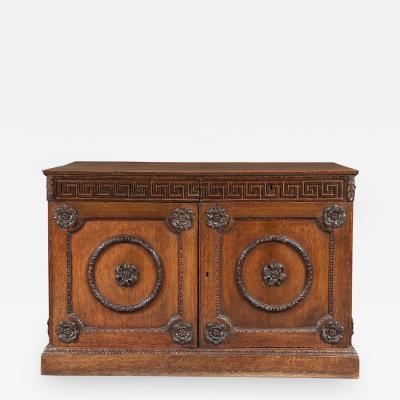 An Oak Two Door Folio Cabinet With Carved Kentian Detailing