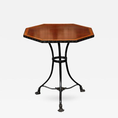 An Octagonal Occasional Table with Satinwood Banded Top on a Cast Iron Base