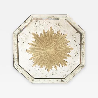 An Octagonal Verre Eglomise Mirror
