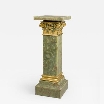 An Onyx Pedestal With A Revolving Top