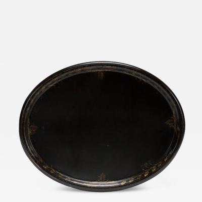 An Oval Black Tole Tray with Gilt Detailing