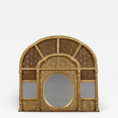 An Overmantel Mirror With Panels Of Mughal Inspired Carved Geometric Tracery