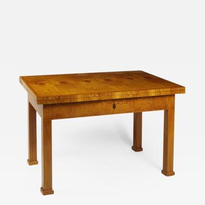 An Unusual Biedermeier Swivel Top Folding Table