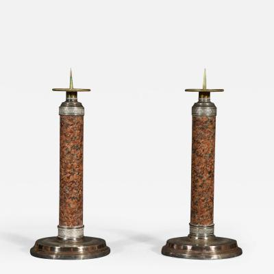 An Unusual Pair of Silver Plated and Balmoral Granite Candlesticks