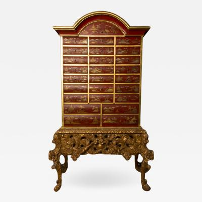 An antique chinoiserie lacquer storage cabinet on carved giltwood stand