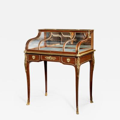 An attractive and unusual Napoleon III mahogany display table