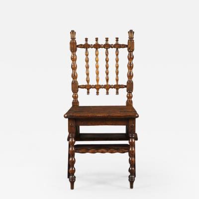 An early 20th century Arts and Crafts period Oak metamorphic chair