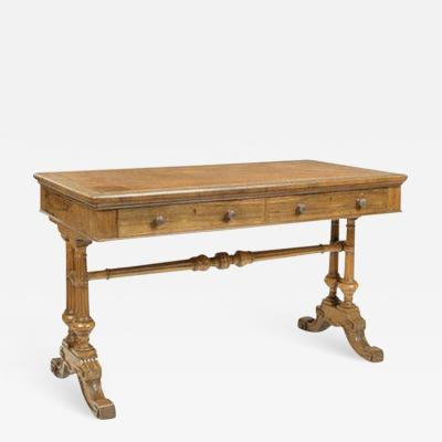 An early Victorian rosewood writing table by Holland Sons