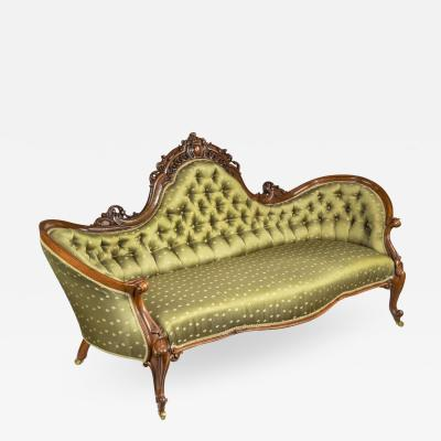An elaborate Victorian shaped walnut sofa