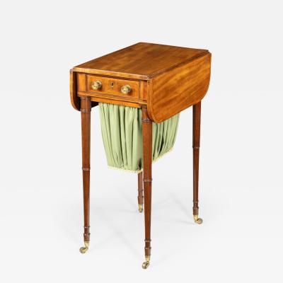 An elegant George III mahogany Pembroke sewing table