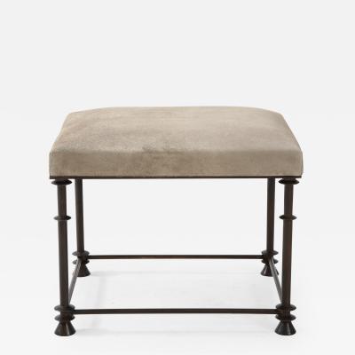 An elegant bronze stool covered with nubuck retourn