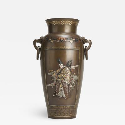 An exquisite Japanese Bronze and multi metal vase depicting a Samurai Archer