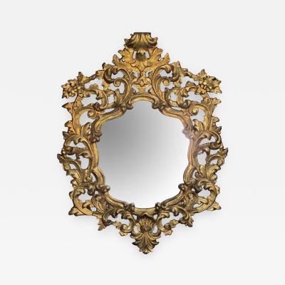 An exuberant Italian rococo revival carved gilt wood mirror