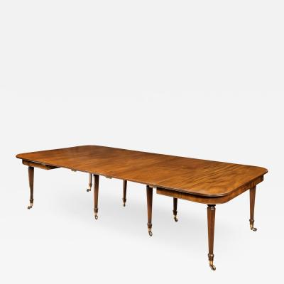 An imperial action mahogany extending dining table attributed to Gillows