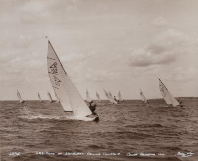 An original Beken photograph of HRH duke of Edinburgh leading the fleet