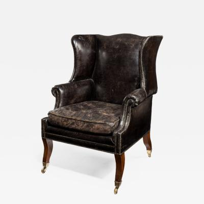 An unusual Regency mahogany sabre leg arm chair