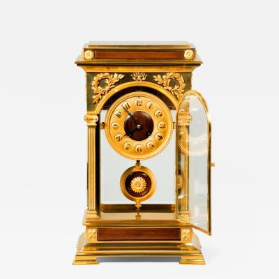 An unusual and superb quality rectangular four glass ormolu mantel clock