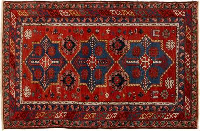 Antique Caucasian hand woven wool rug