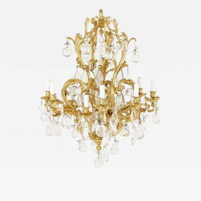Antique Rococo style ormolu and cut glass twelve light chandelier