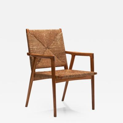 Armchair in Solid Oak and Cane Denmark ca 1960s